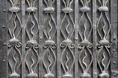 Texture  with decorative iron elements. Vintage texture of a metal surface with decorative wrought iron elements Royalty Free Stock Photos