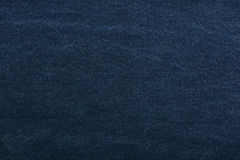 Texture denim. Dense tissue. Textiles. Background. Dark blue natural fabric. Royalty Free Stock Photography