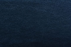 Texture denim. Dense tissue. Textiles. Background. Dark blue natural fabric. Royalty Free Stock Image