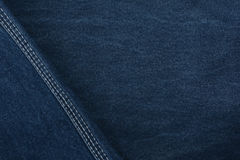 Texture denim. Dense tissue. Textiles. Background. Dark blue natural fabric. Stock Photography