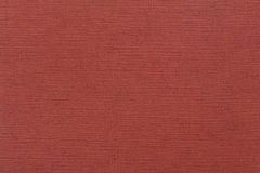 Texture of dense cardboard with vinous velvety coating. Royalty Free Stock Photos