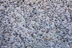 Texture des pierres Lissez les pierres polies lavées à terre sur le fond de plage photographie stock libre de droits