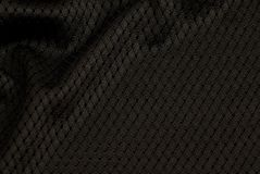Texture of a Black Mesh Football Jersey Up Close Stock Photo