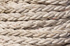 Texture detail of twisted rope wound up on a reel - Close up. Image royalty free stock photos