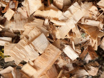 Texture and detail of wood chippings outside overhead. Brown wood bits and chips in a pile pattern stock photos