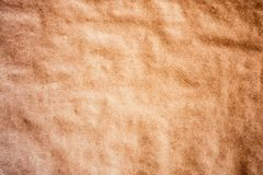 Texture detailed background craft wrapping wrinkled paper. Parchment recycled  vignetting toned macro shot Royalty Free Stock Images