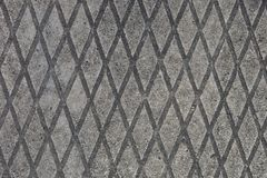 Texture of a diamond-shaped concrete surface. royalty free stock images