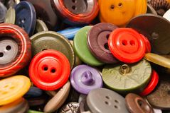 Texture of different colored clothing buttons. Closeup Royalty Free Stock Image