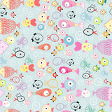 Texture of different fish. Seamless pattern of multicolored fish funny on a gray background Stock Photography