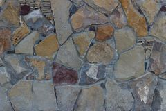 Texture of different stones wall background design frontal detailed multi-colored stock photography