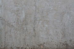 Texture of the dirty gray polished concrete wall with scratches background Stock Images