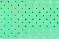 Texture of dirty green metal with holes Royalty Free Stock Image