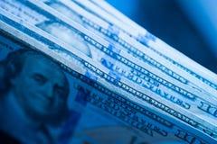 Texture of dollar bills in blue tones stock photo