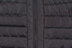 Texture down black jacket with zipper. Texture of black down jacket with zipper close up Stock Photos