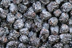 Texture of dried black aronia berries Stock Image