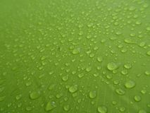 Texture: a drop of water on a green fabric. Water-repellent effect. Waterproof textile stock photography