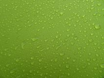 Texture: a drop of water on a green fabric. Water-repellent effect. Waterproof textile royalty free stock image