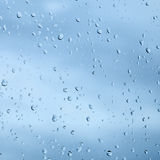 Texture from droplets of rain water. On a windowpane surface Royalty Free Stock Images