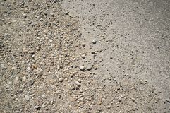 Texture of Dusty and Rocky Road with Car and Bicycle Trails stock photo