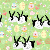 Texture Easter bunnies. Seamless pattern with Easter bunnies and eggs on a green background royalty free illustration