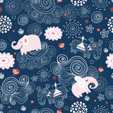 Texture of elephants in the clouds. Seamless pattern of pink elephants in the clouds on a dark blue background Royalty Free Stock Photo