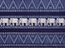 Texture of Elephants Pattern on Cloth Fabric in Dark Navy Blue and White. Royalty Free Stock Photo