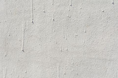 Texture of an embossed antique concrete wall with cracks and a ruined plaster protective layer Royalty Free Stock Photo
