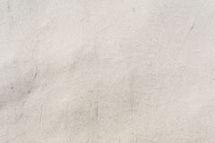 Texture of an embossed antique concrete wall with cracks and a ruined plaster protective layer Royalty Free Stock Photography