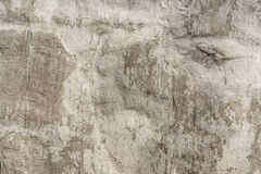 Texture of an embossed antique concrete wall with cracks and a ruined plaster protective layer Royalty Free Stock Photos