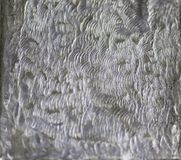 Texture with embossed. Drawing on tin foil stock photos