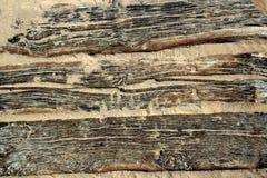 Texture en bois âgée de plage avec le sable superficiel par les agents Photographie stock libre de droits