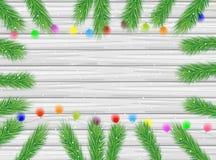 Texture en bois avec les branches de l'arbre de Noël et du GA lumineux Photographie stock