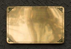 Texture en laiton brillante de signe en métal photographie stock