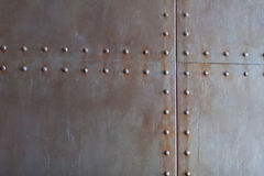 Texture en métal avec des rivets Photo libre de droits