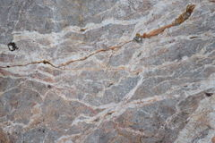 Texture en pierre avec des fissures et des trous Photo stock