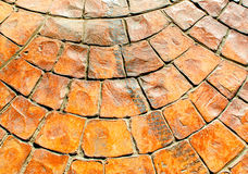 Texture en pierre orange de trottoir de bloc Photo stock