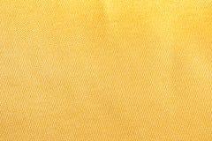Texture en soie de tissu d'or pour le fond Photos stock