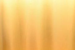 Texture en soie de tissu pour le fond d'or Photos stock