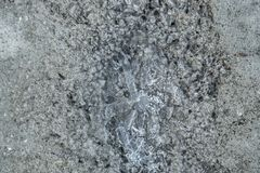The texture is erased, damaged concrete coating.  stock photo