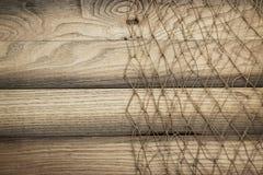 Texture et filet de pêche en bois de fond Images stock