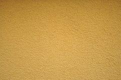Texture et fond jaunes de mur de homogen Photographie stock