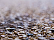 Texture of the exposed aggregate finish flooring. Non slip Stock Photos
