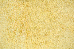 Background fabric. Yellow texture on the fabric cloth Stock Images