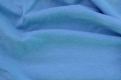 The texture of the fabric in blue color. Material for making shirts and blouses.  royalty free stock photos