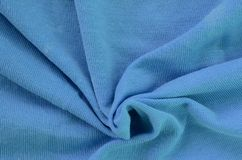 The texture of the fabric in blue color. Material for making shirts and blouses.  stock photography