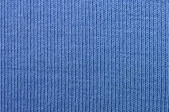 The texture of the fabric in blue color. Material for making shirts and blouses.  stock photo
