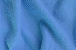 The texture of the fabric in blue color. Material for making shirts and blouses.  royalty free stock photo