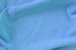 The texture of the fabric in blue color. Material for making shirts and blouses.  royalty free stock photography