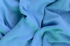 The texture of the fabric in blue color. Material for making shirts and blouses.  stock images