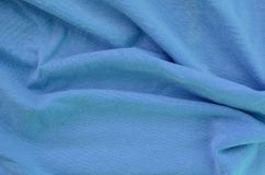 The texture of the fabric in blue color. Material for making shirts and blouses.  stock photos